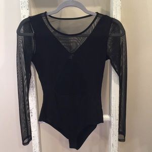 Body suit with mesh cut out